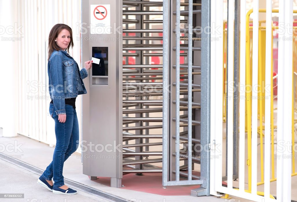 Young woman puts the card into the reader system stock photo