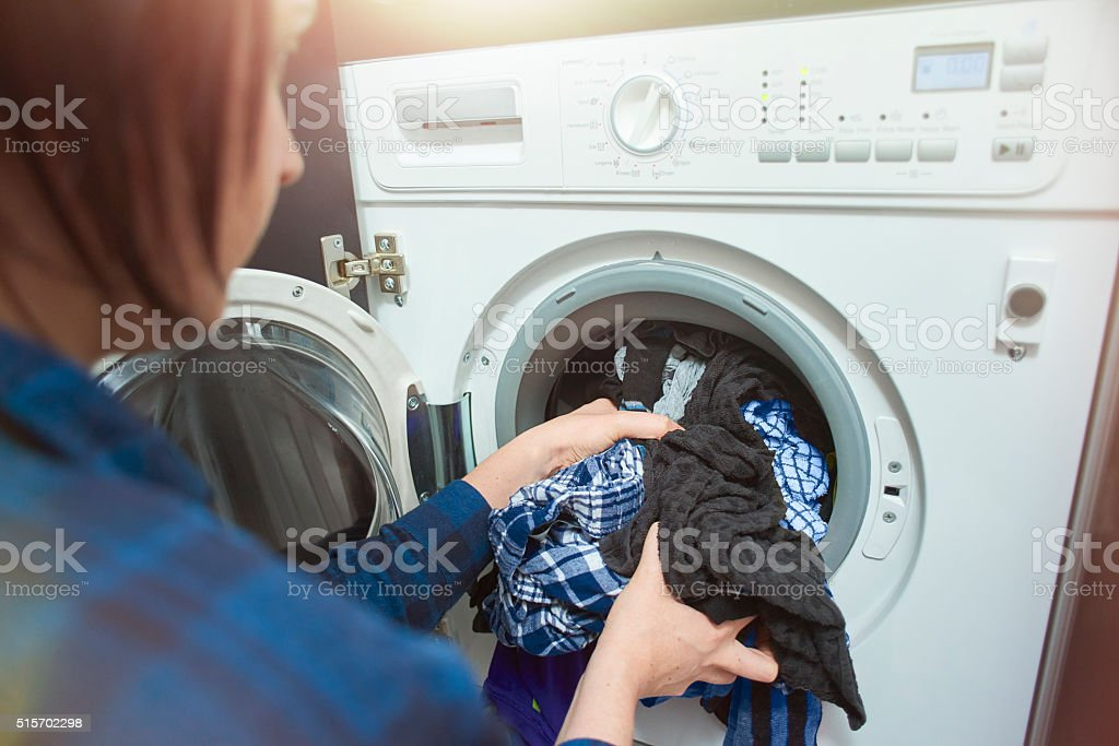 Young woman putting a wash on. stock photo