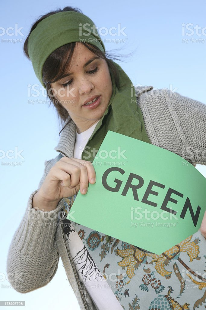 Young Woman Putting Go Green Sign In Her Purse stock photo