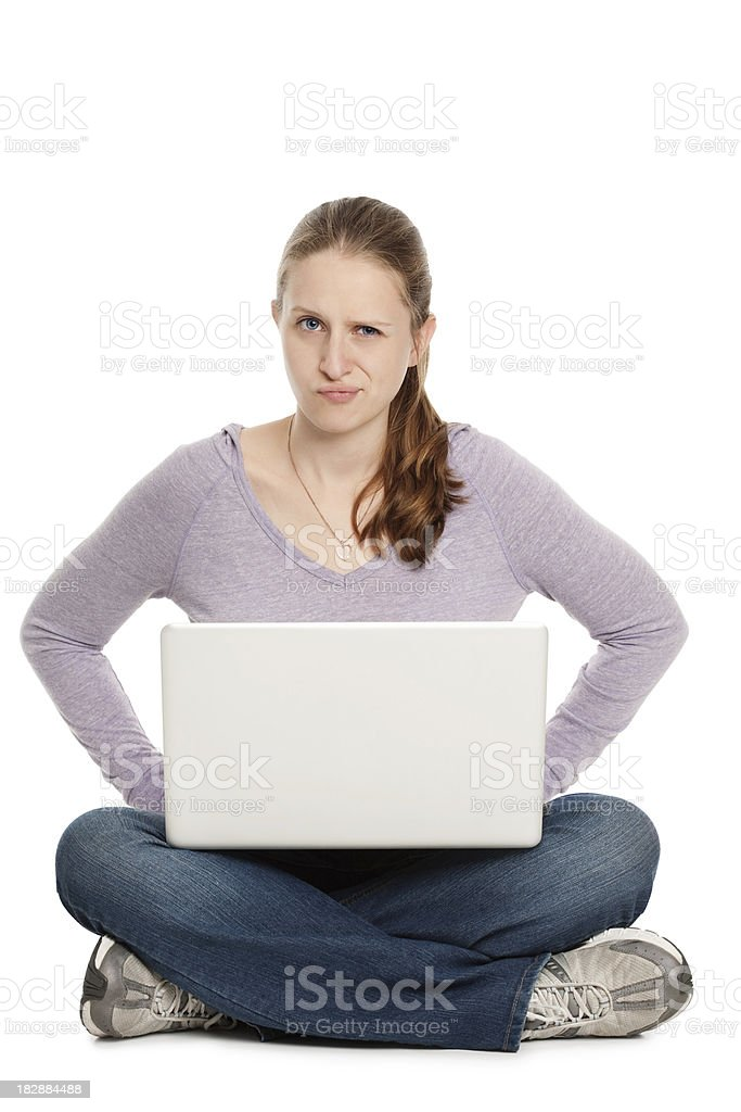 Young Woman Questioning Technology With Laptop in Lap royalty-free stock photo