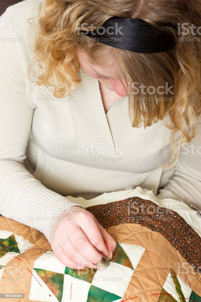 Young Woman Quilting stock photo
