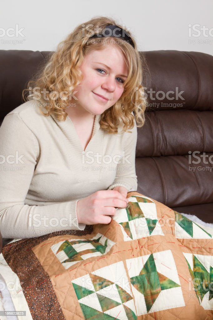 Young Woman Quilting royalty-free stock photo