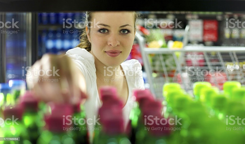 Young Woman reaching for a bottle royalty-free stock photo