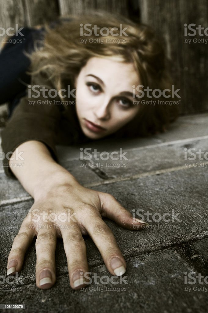 Young Woman Reaching Hand Out royalty-free stock photo