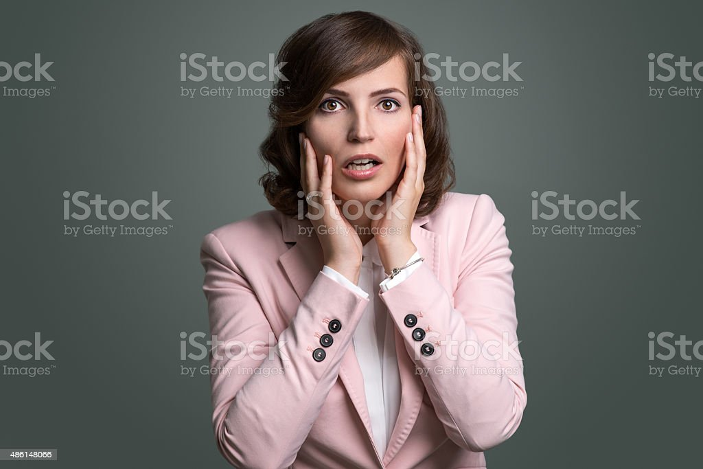 Young woman reacting in shock and horror stock photo
