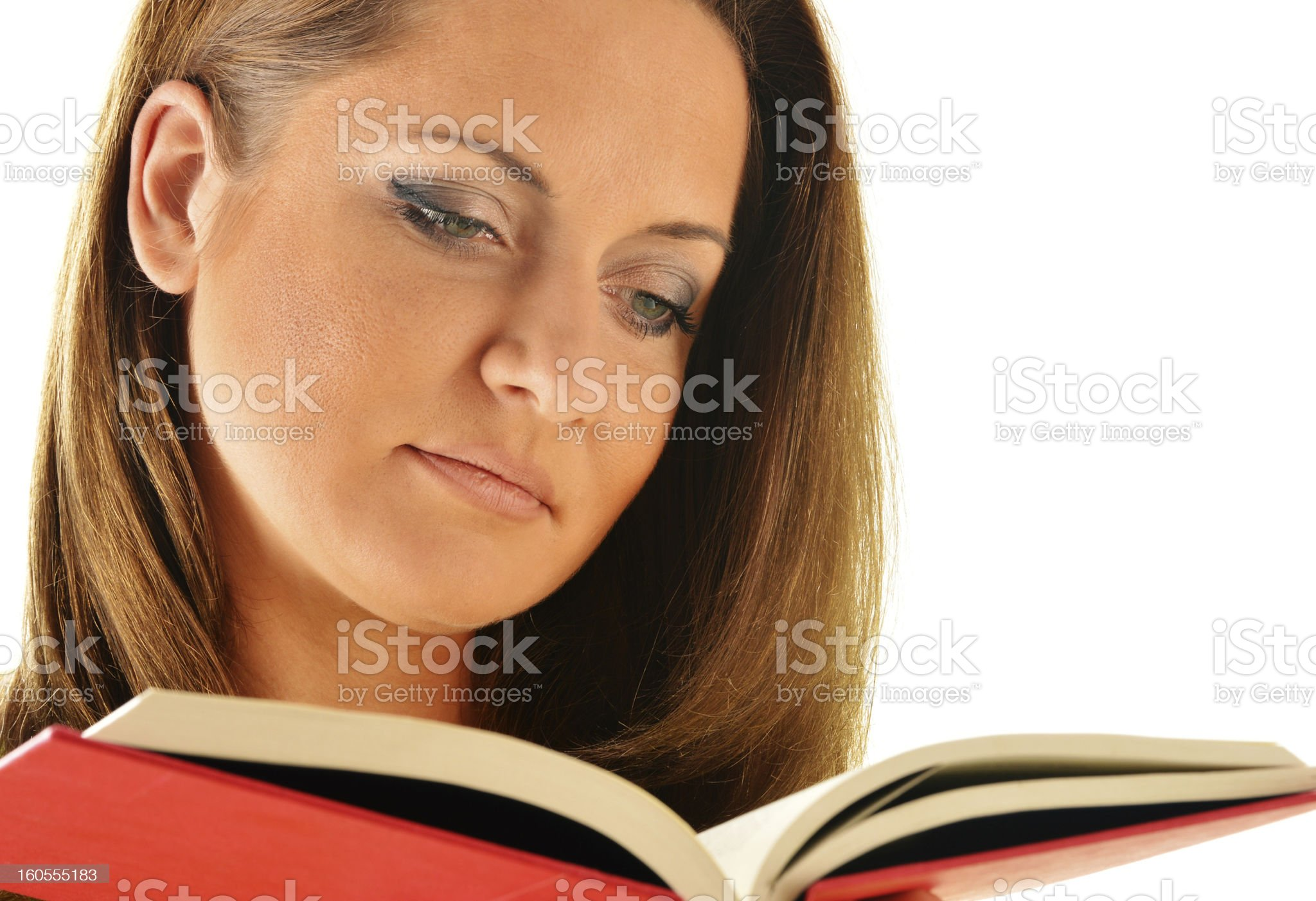 Young woman reading a book isolated on white royalty-free stock photo