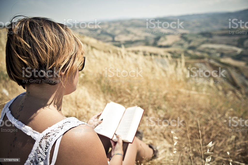 Young woman reading a book royalty-free stock photo