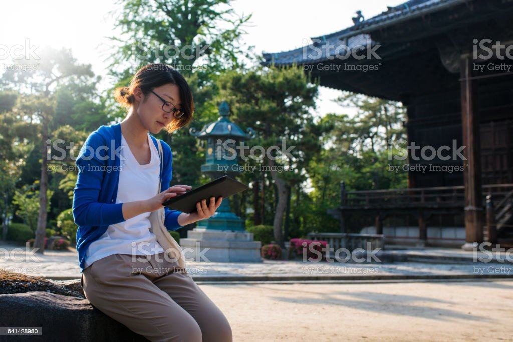 Young woman reading a digital tablet stock photo