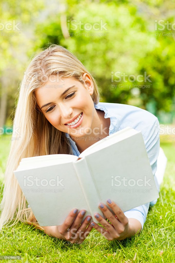 Young Woman Reading Book In Park. royalty-free stock photo