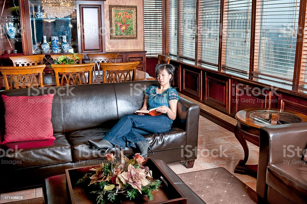 Young woman reading book indoor royalty-free stock photo