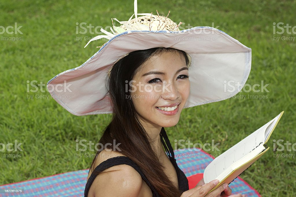 young woman reading book royalty-free stock photo