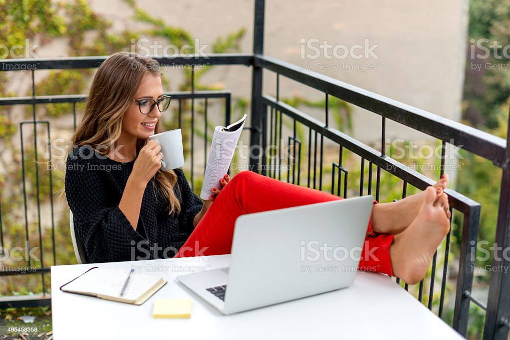 Young woman reading book stock photo