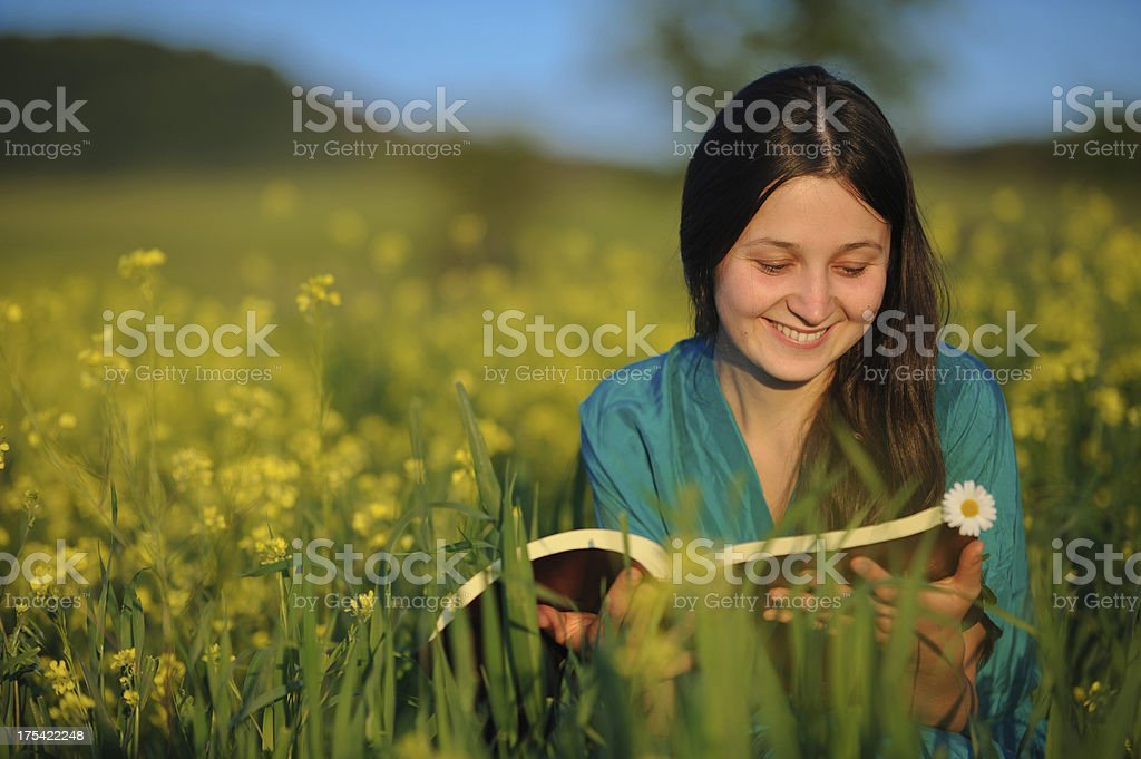 Young woman reading from bible. stock photo
