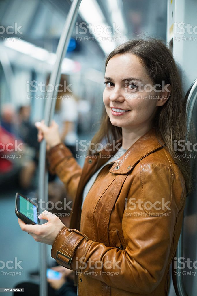 Young woman reading from mobile phone screen stock photo