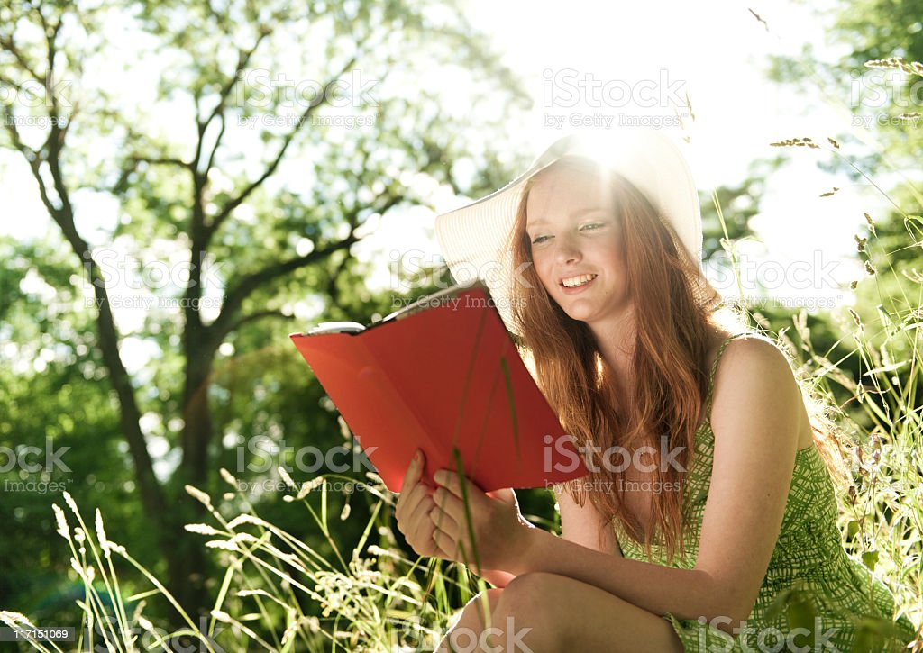 Young Woman reading in the park royalty-free stock photo