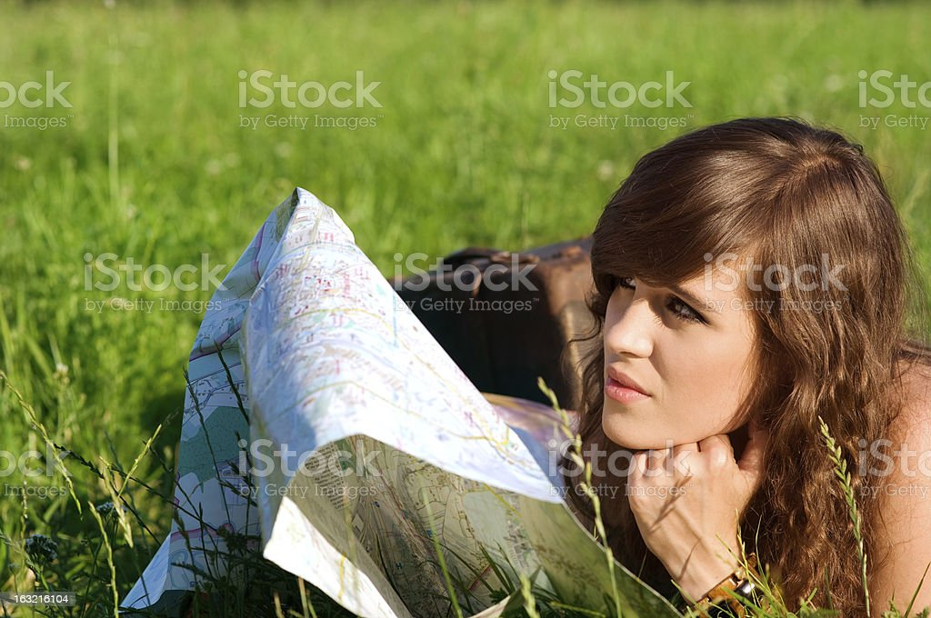 Young woman reading map royalty-free stock photo