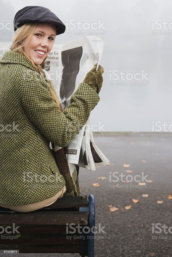 Young woman reading newspaper royalty-free stock photo