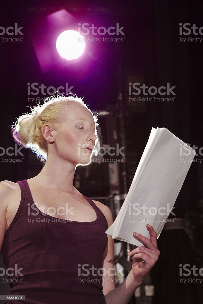 Young Woman Reading Script On Stage stock photo