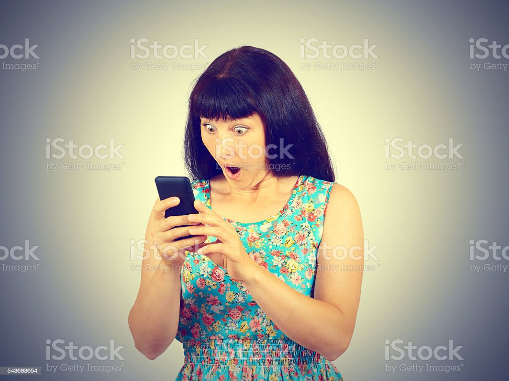young woman reads the SMS, the news on the phone. stock photo