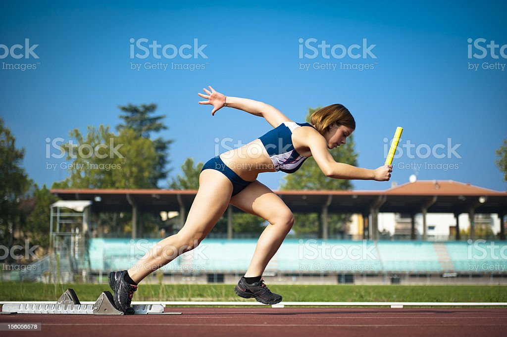 Young woman ready for a running race royalty-free stock photo