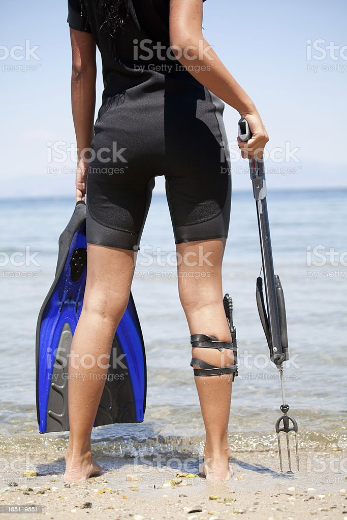 Young woman ready for the underwater fishing stock photo
