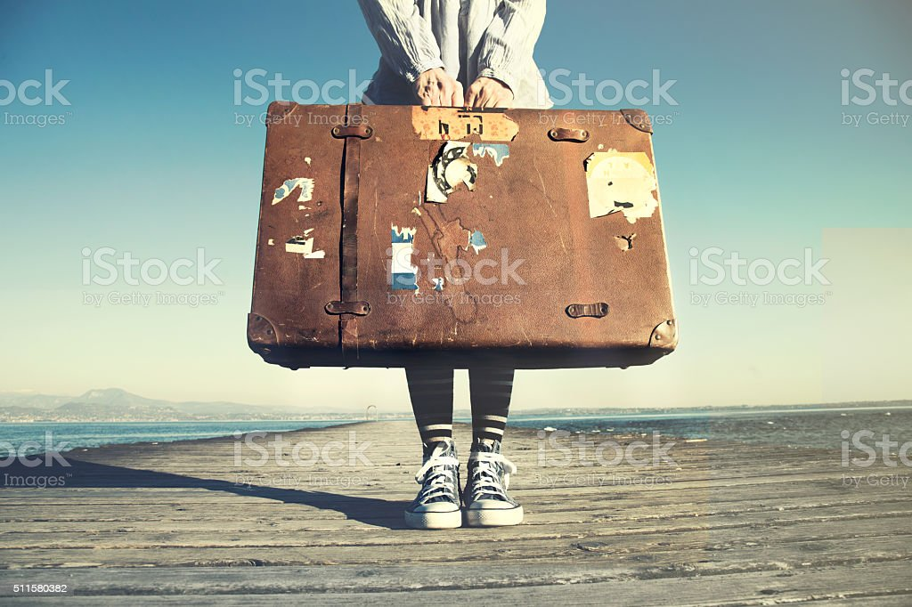 young woman ready to travel with her suitcase stock photo