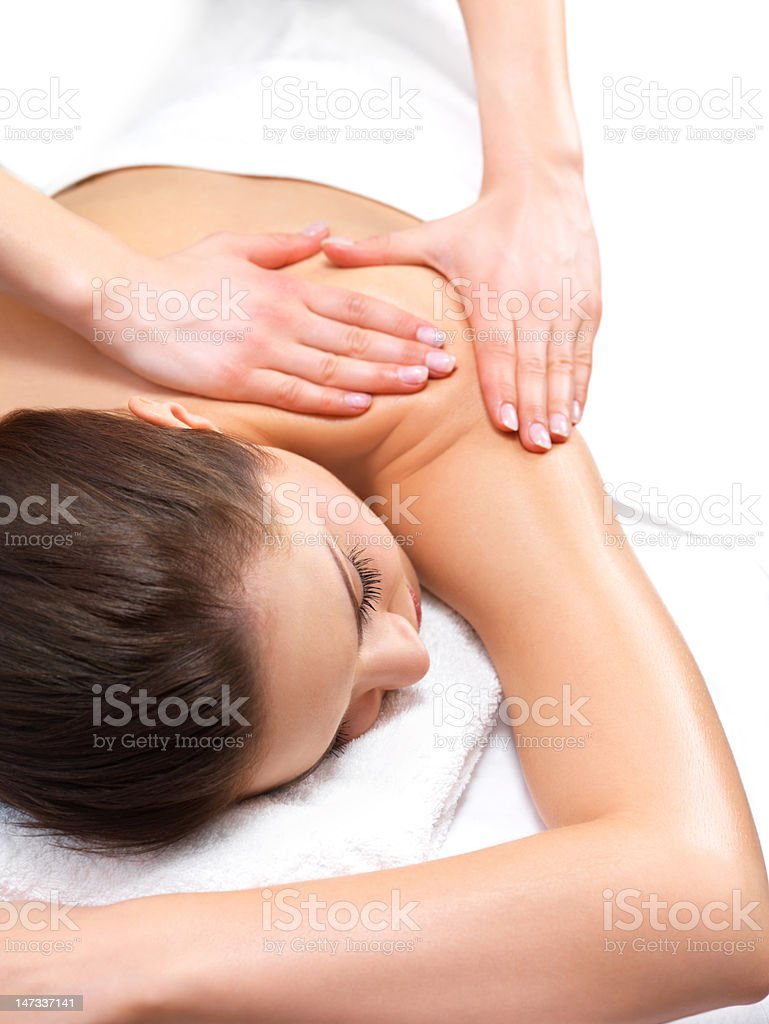 Young woman receiving a back massage stock photo