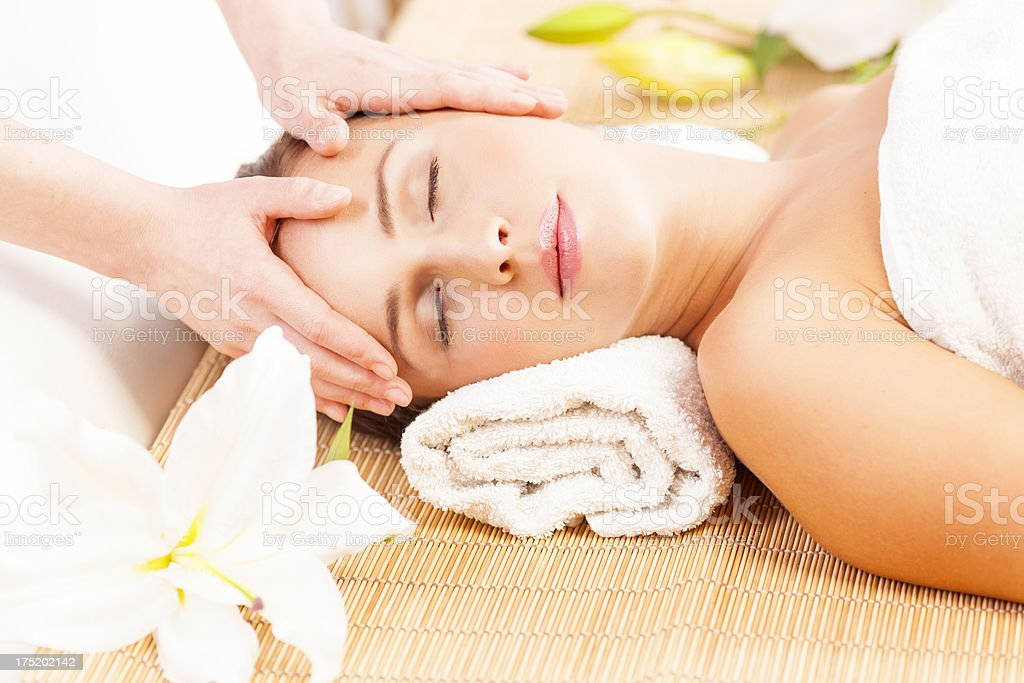 Young woman receiving a head massage royalty-free stock photo