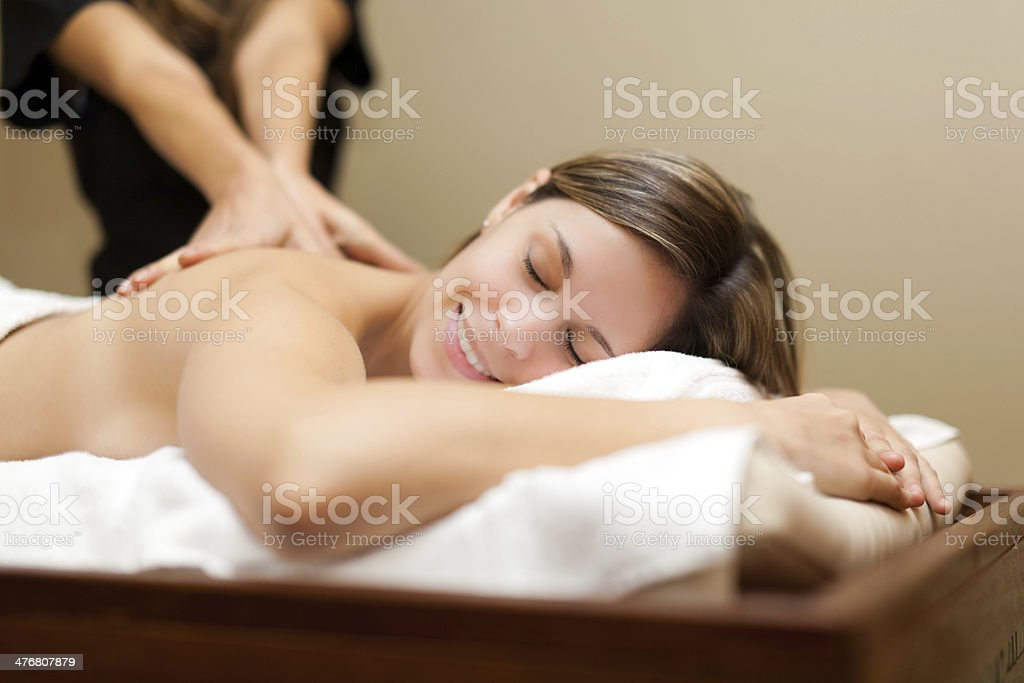 Young woman receiving a massage stock photo