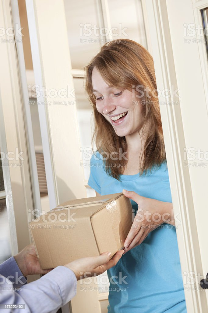 Young Woman Receiving a Package from Delivery Service Vt royalty-free stock photo
