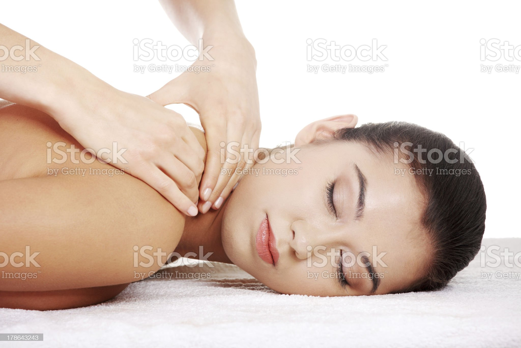 Young woman receiving back massage at spa royalty-free stock photo