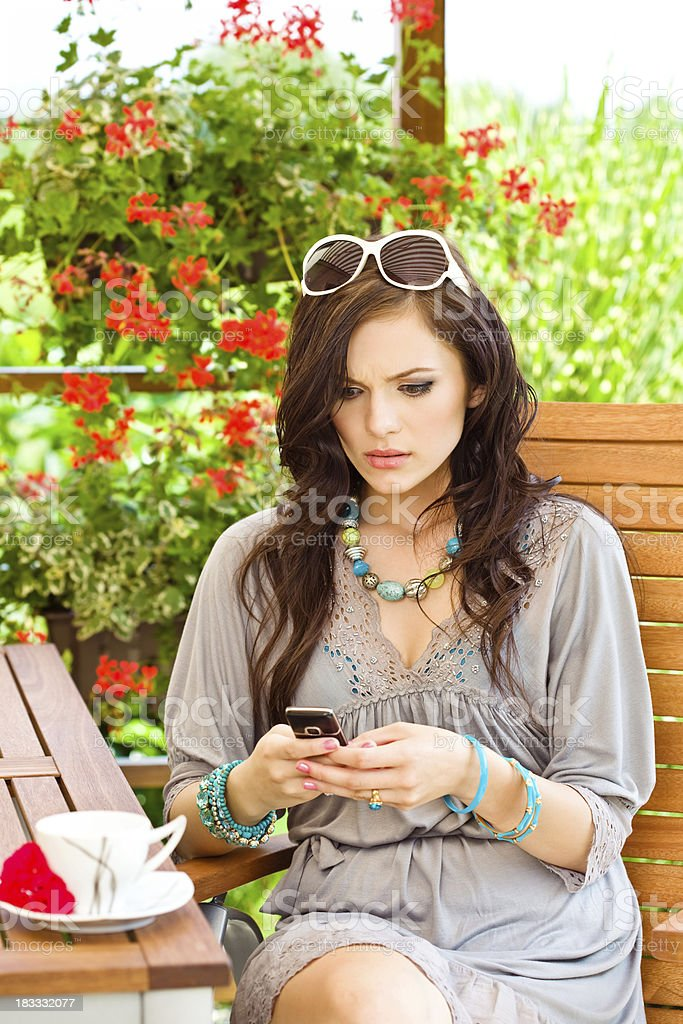 Young woman receiving bad news royalty-free stock photo