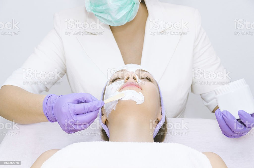 Young woman receiving beauty therapy royalty-free stock photo