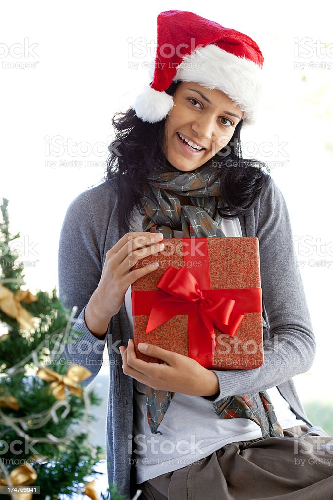 young woman receiving Christmas present royalty-free stock photo