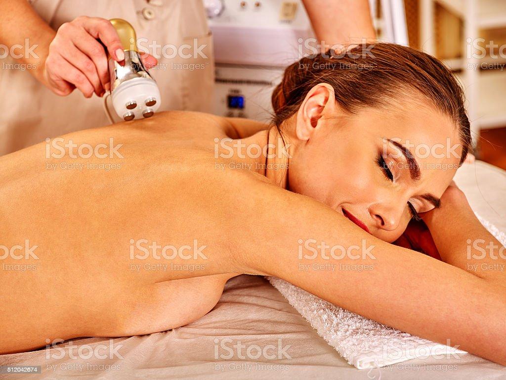 Young woman receiving electric facial massage stock photo