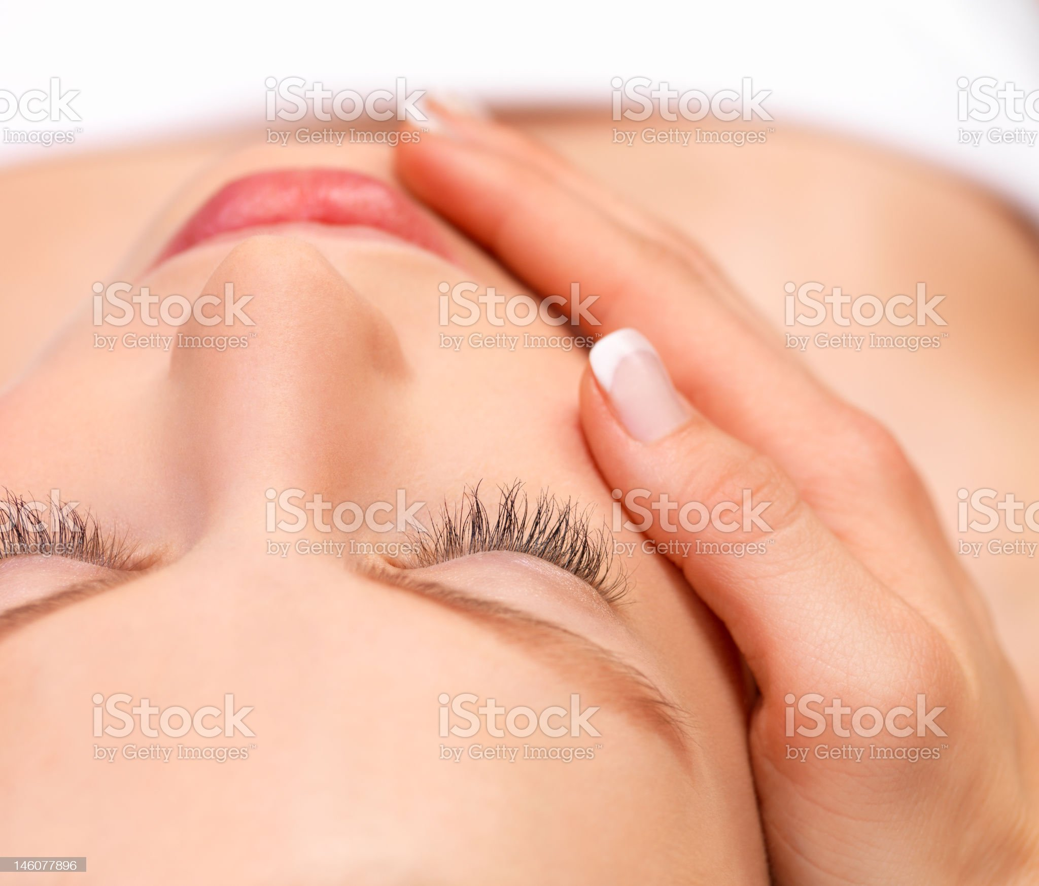 Young woman receiving face massage royalty-free stock photo