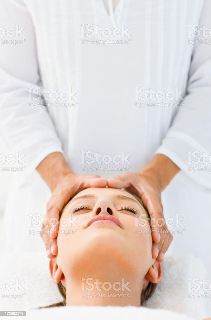 Young woman receiving head massage at spa royalty-free stock photo