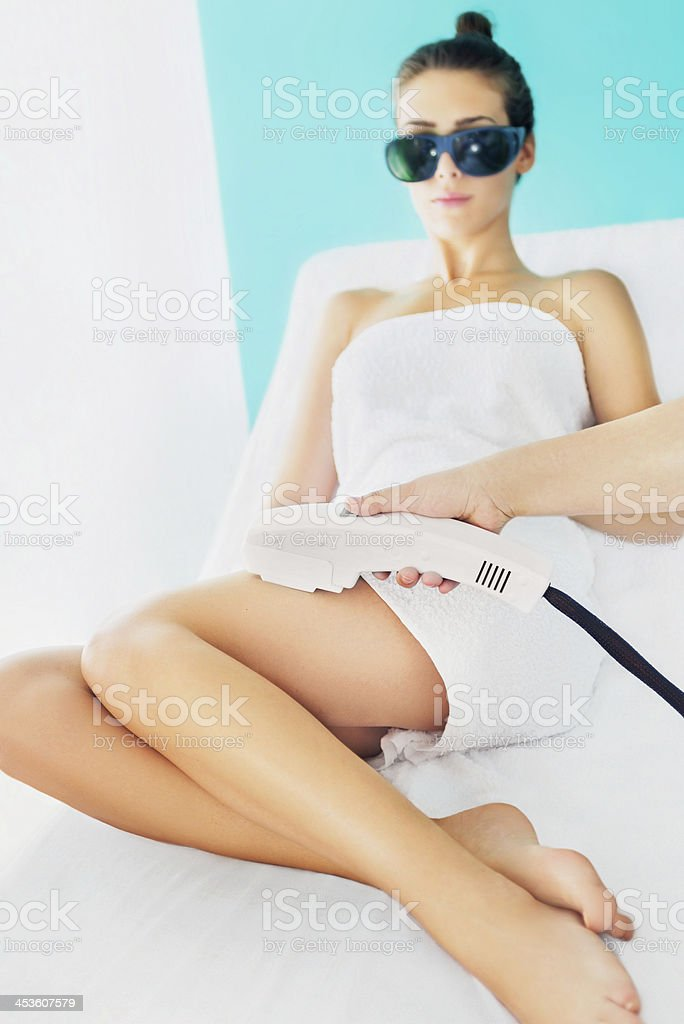 Young woman receiving laser epilation treatment stock photo
