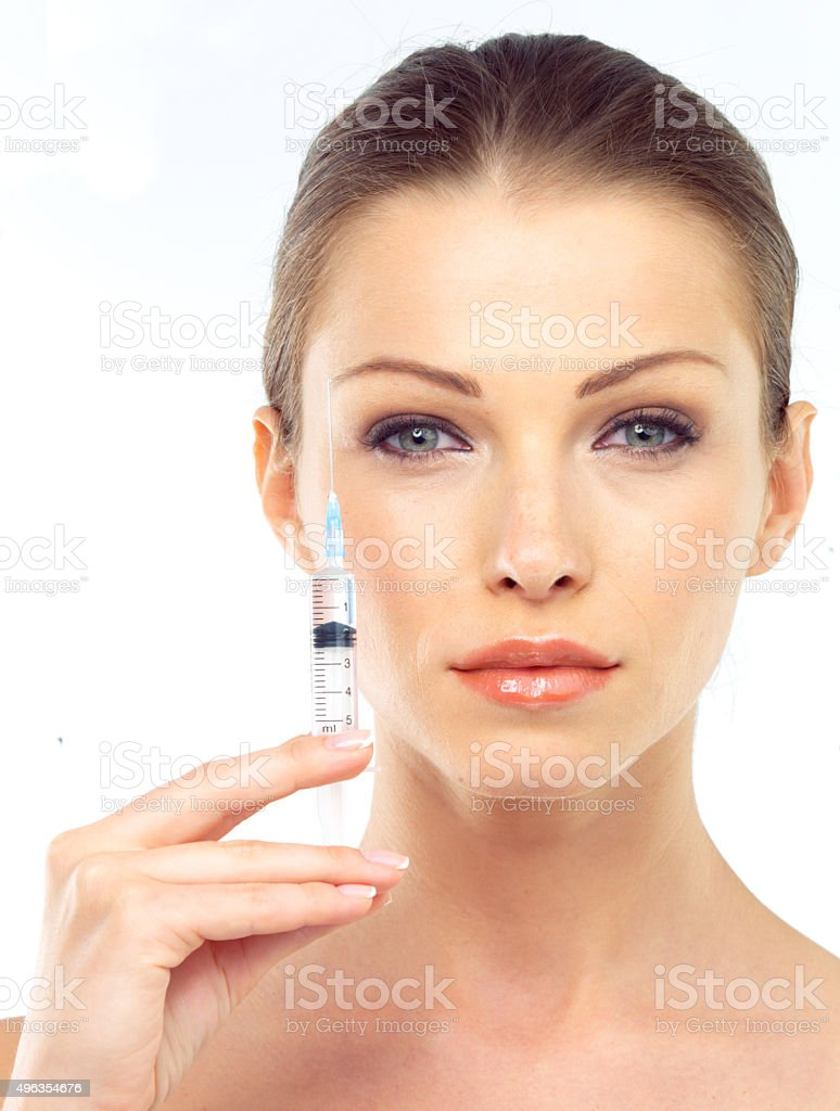 Young woman receiving multiple lifting injections stock photo