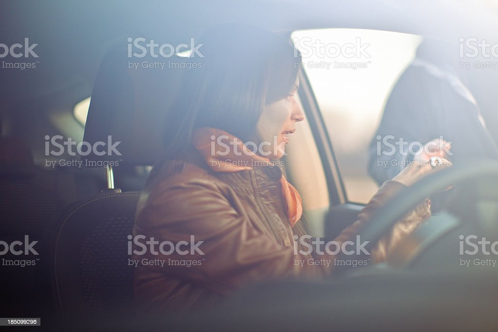 Young woman receiving speeding ticket from police officer stock photo