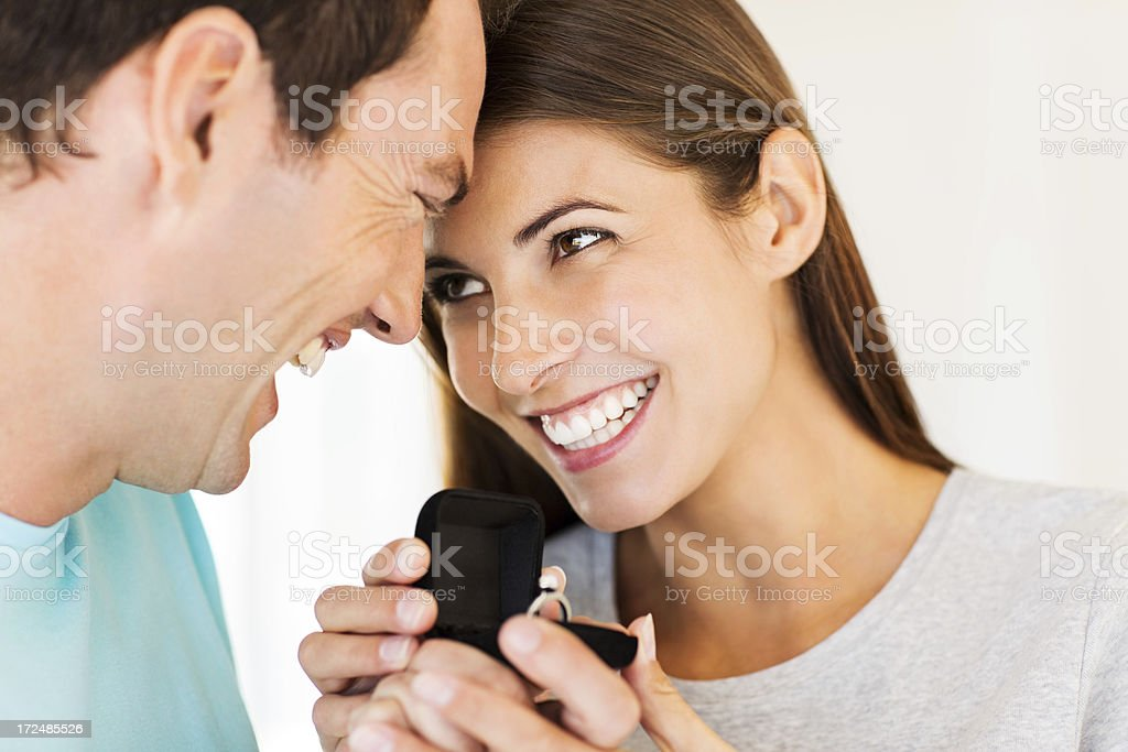 Young Woman Receiving Wedding Ring From Boyfriend royalty-free stock photo