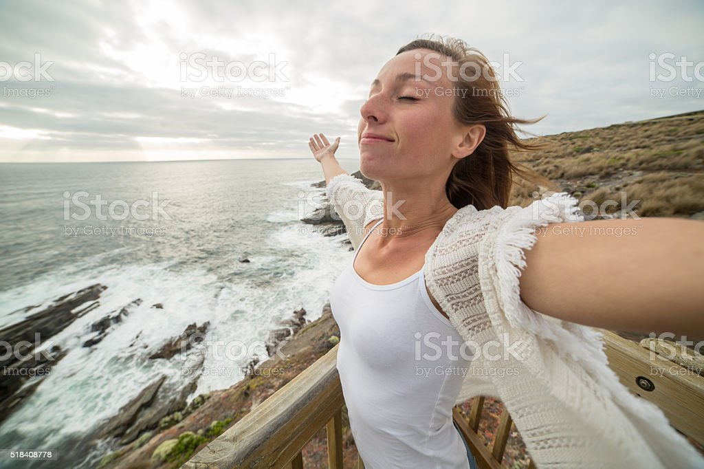 Young woman relaxes by the sea stock photo
