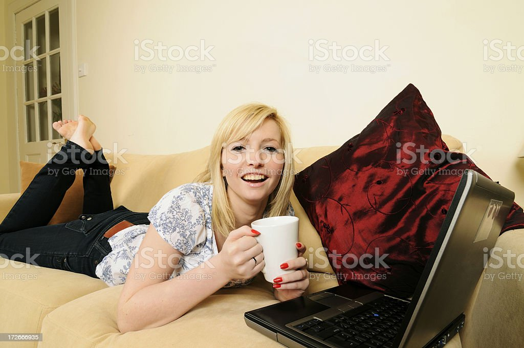 Young woman relaxes with Laptop stock photo