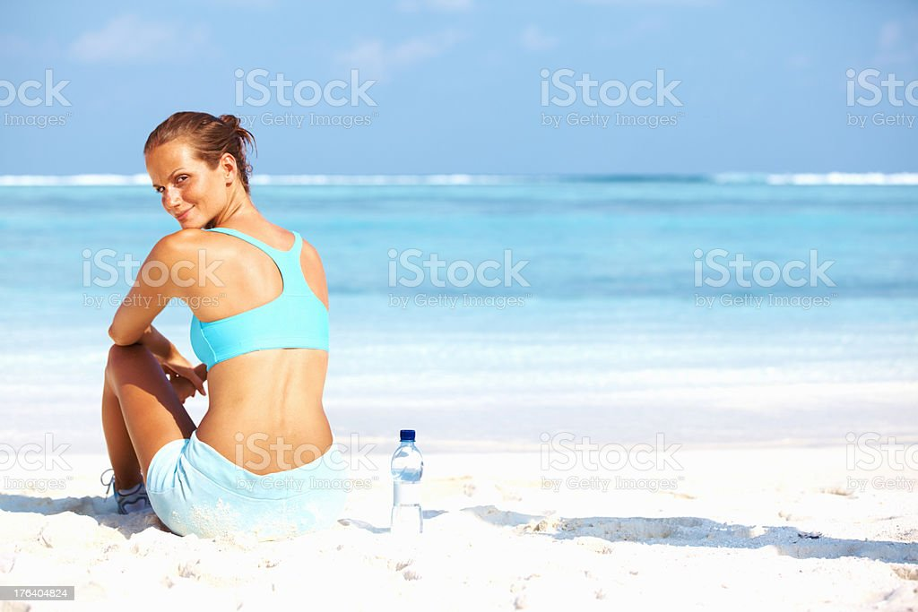Young woman relaxing after a run stock photo