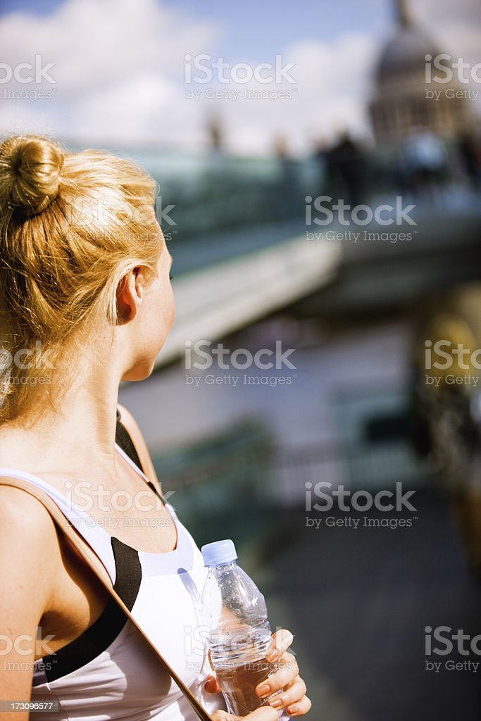 Young Woman relaxing after exercising in London royalty-free stock photo