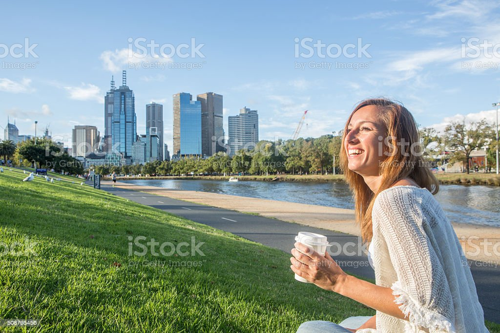 Young woman relaxing along the Yarra river in Melbourne, Australia stock photo