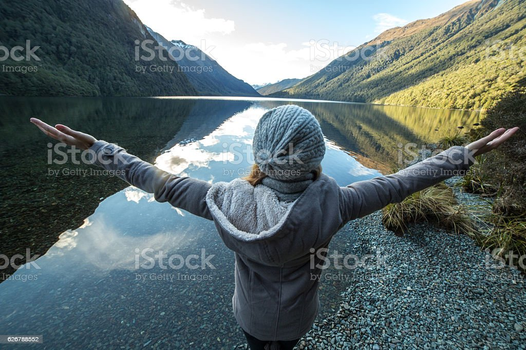 Young woman relaxing by the lake stock photo
