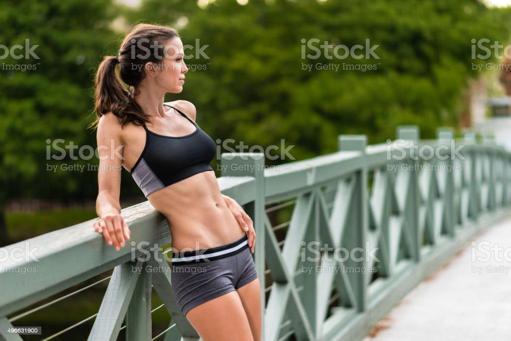 Young Woman Relaxing from Exercising stock photo
