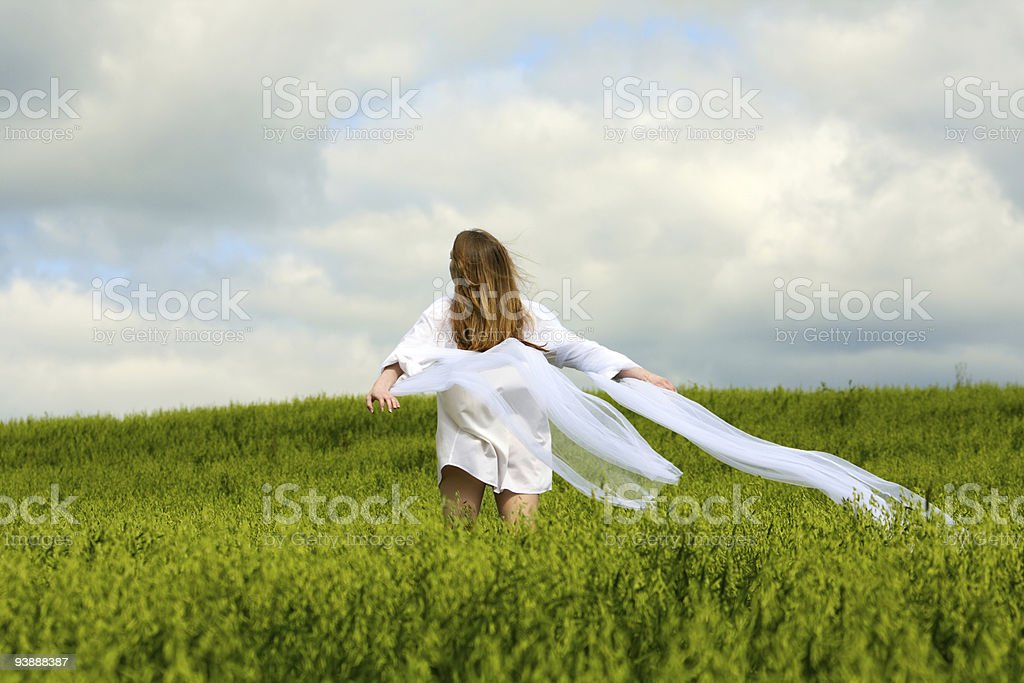 Young woman relaxing  in a field royalty-free stock photo