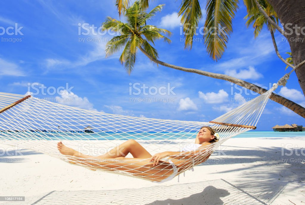 Young woman relaxing in a hammock royalty-free stock photo